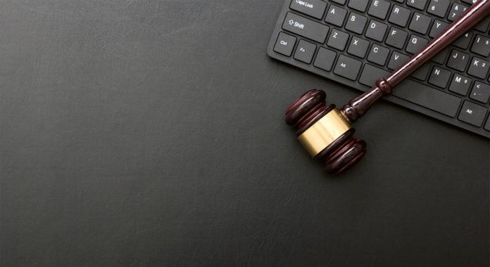 Virtuell Gerichtsverfahren, Foto: AdobeStock/Roman Motizov